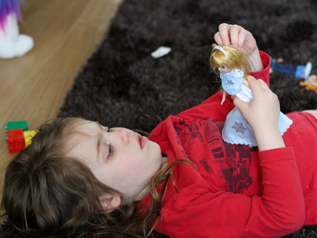 Snow Queen from Lottie Dolls being played with by a small girl lying on her back