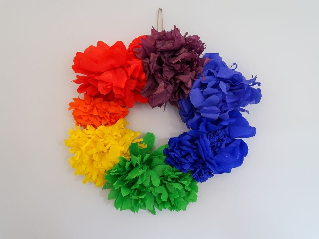 Finished Rainbow Flower Wreath with red, orange, yellow, green, blue, indigo and violet paper flowers