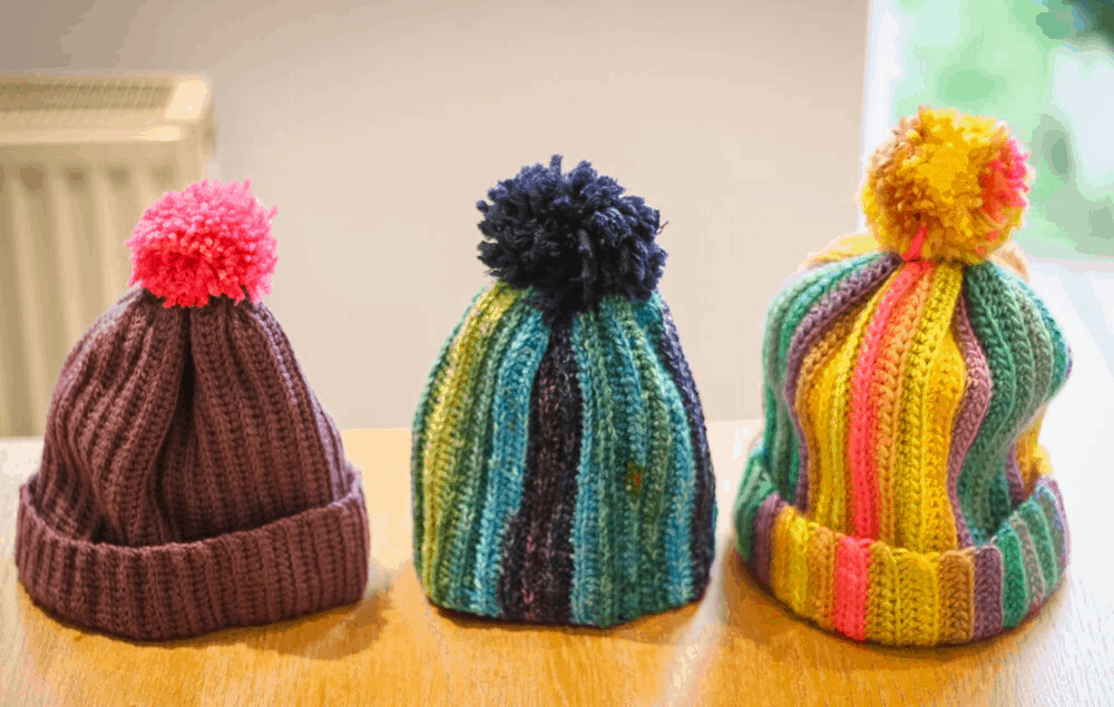 Three multicolured crochet hats with pom poms - crochet for beginners