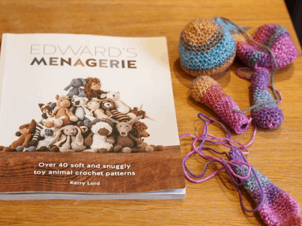 Edward's Menagerie, the book, next to the parts needed to make a crochet bunny