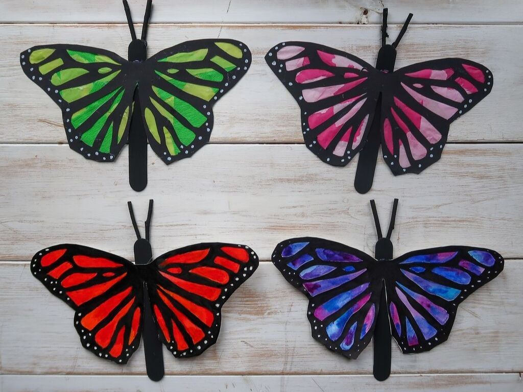 Easy Butterfly Craft puppets in green, pink, orange and purple