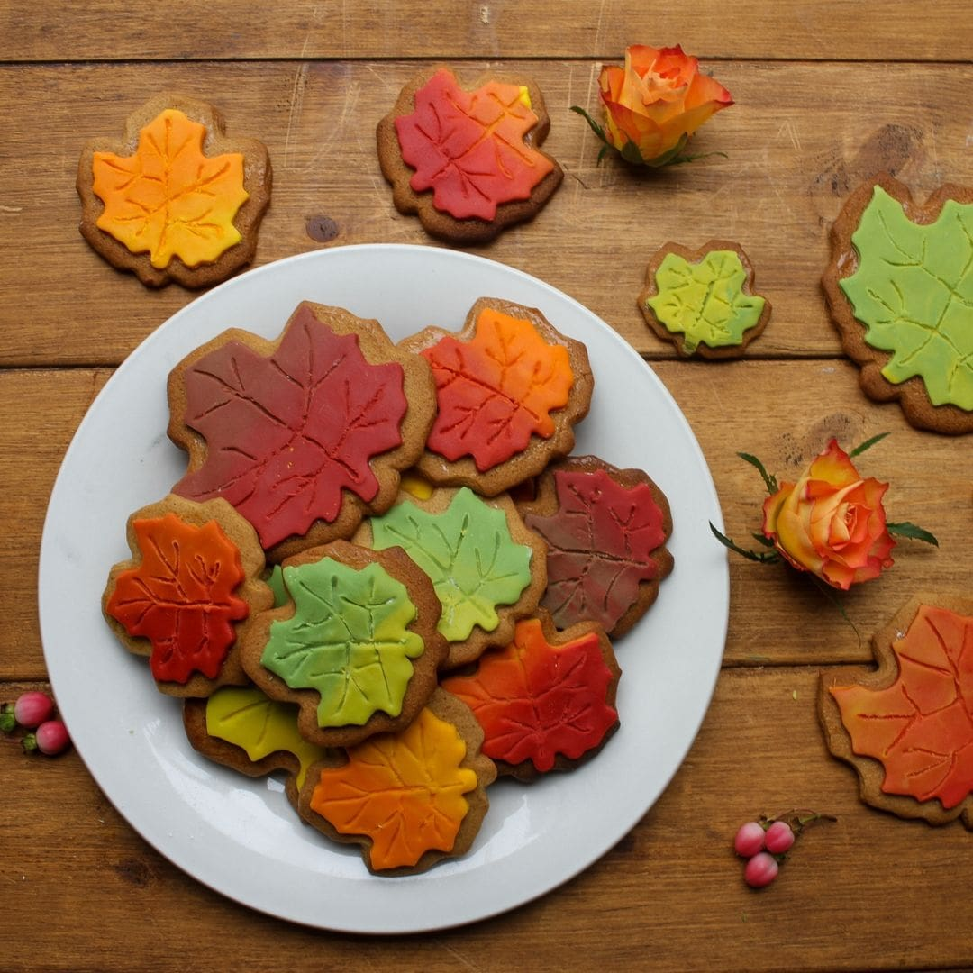 spiced autumn maple leaf cookies on a plate