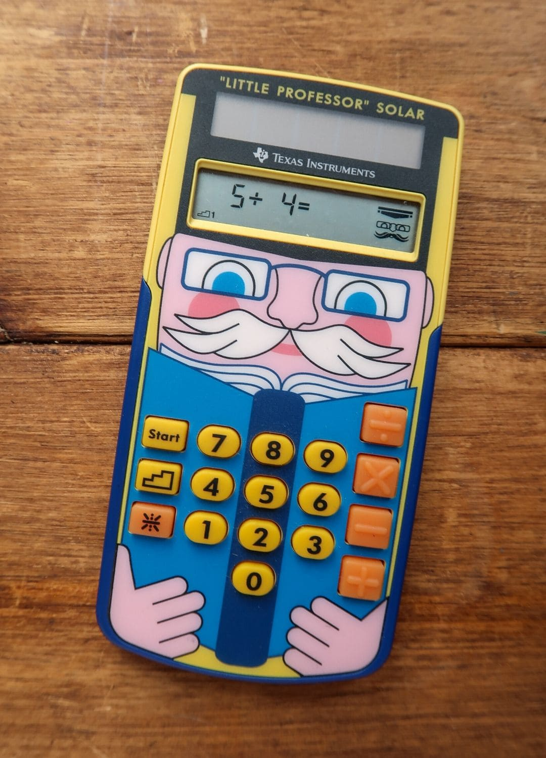 Close-up of little professor maths toy