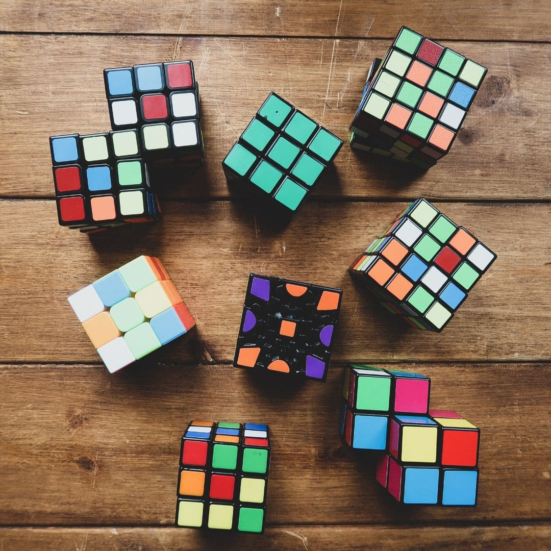 A large collection of different types of Rubik's cubes