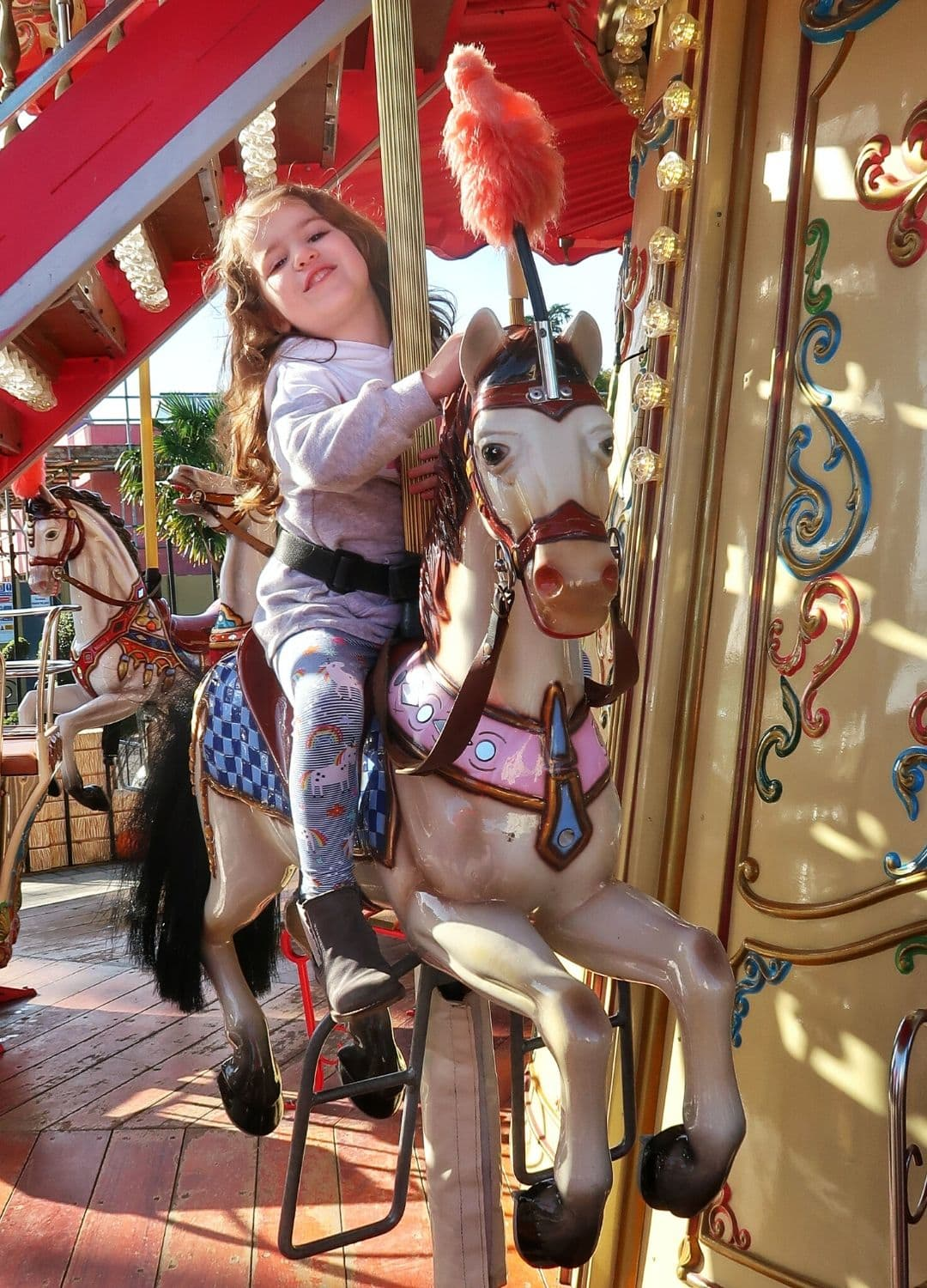 small girl on carousel horse for Paulton's Park review
