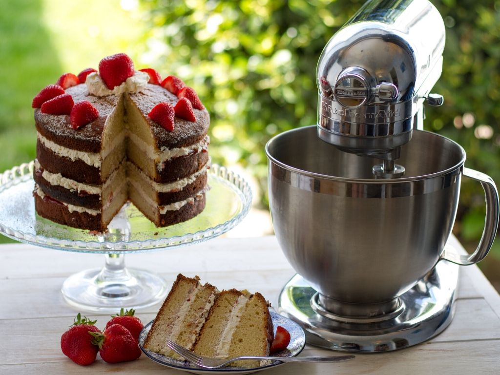 Kitchen Aid stand mixer next to Victoria Sponge cake