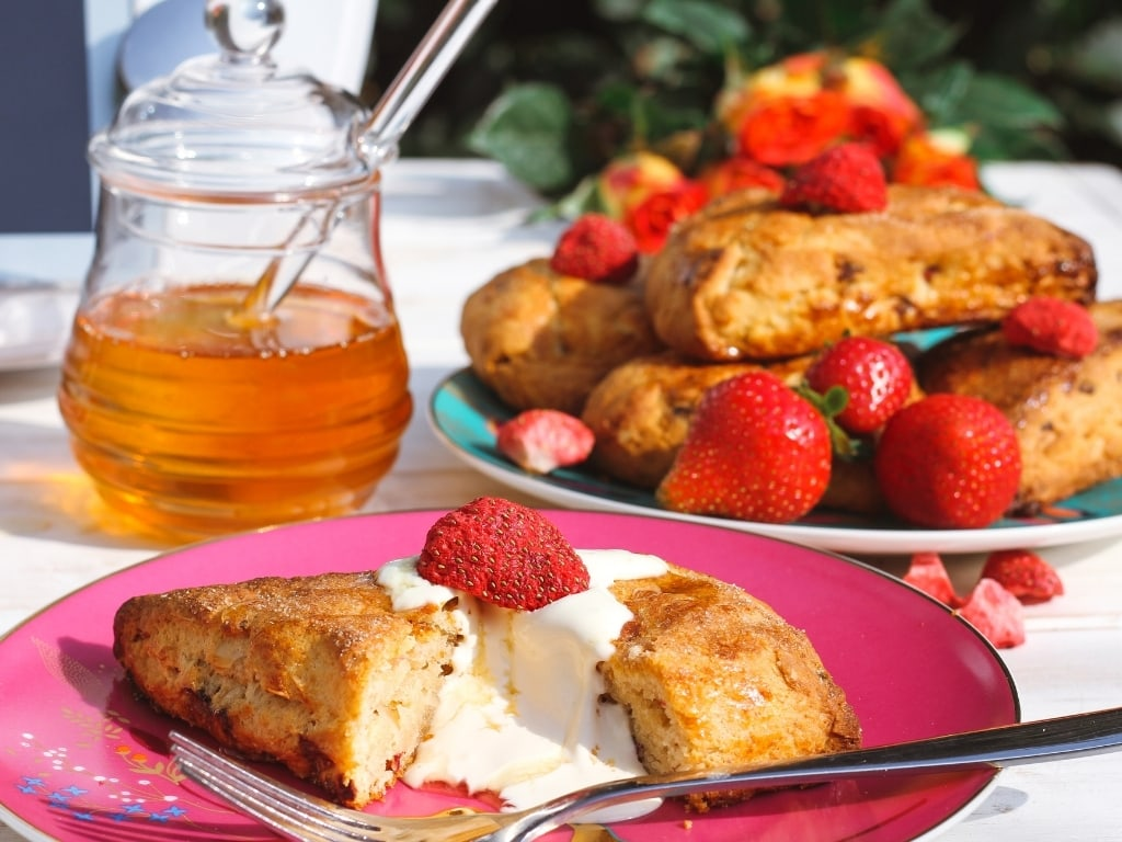 Close up of Stawberry scones with honey pot