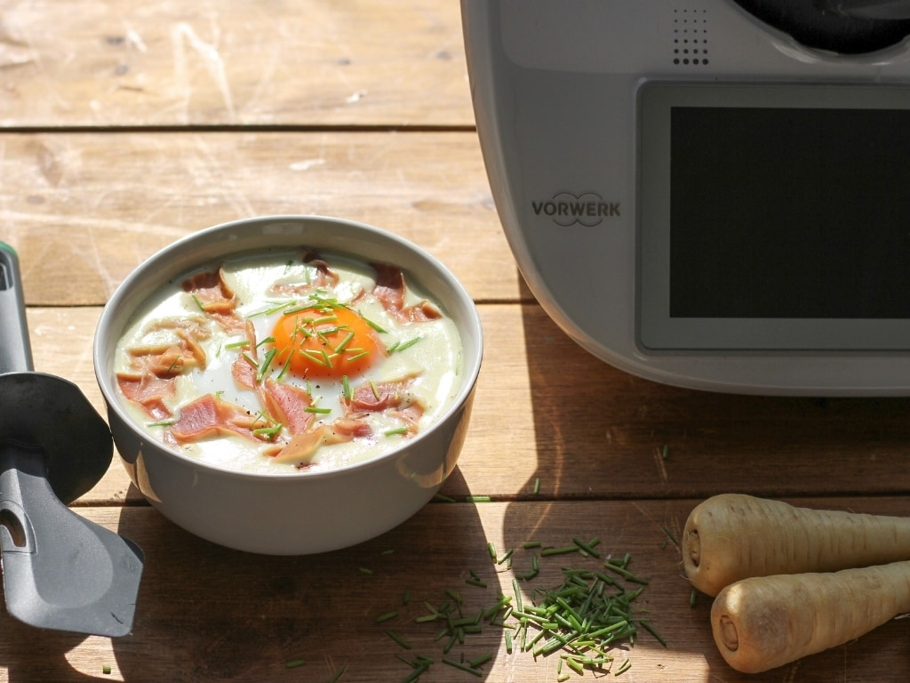 Leek and Parsnip soup with Steamed Eggs and Prosciutto close up with Thermomix